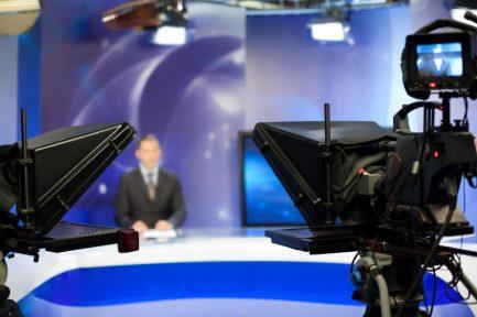 Video camera lens - recording show in TV studio - focus on camera